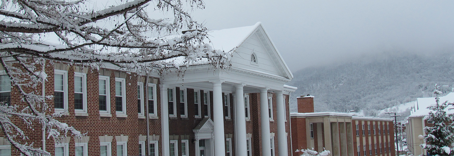 Snowy campus buildings at Potomac State College