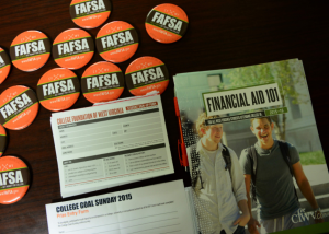 Photo of buttons that say FAFSA and a financial aid booklet