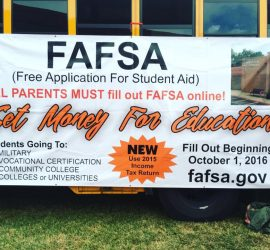 FASFA sign on side of school bus